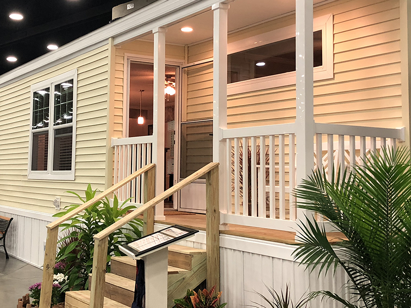 Manufactured home with lit up porch