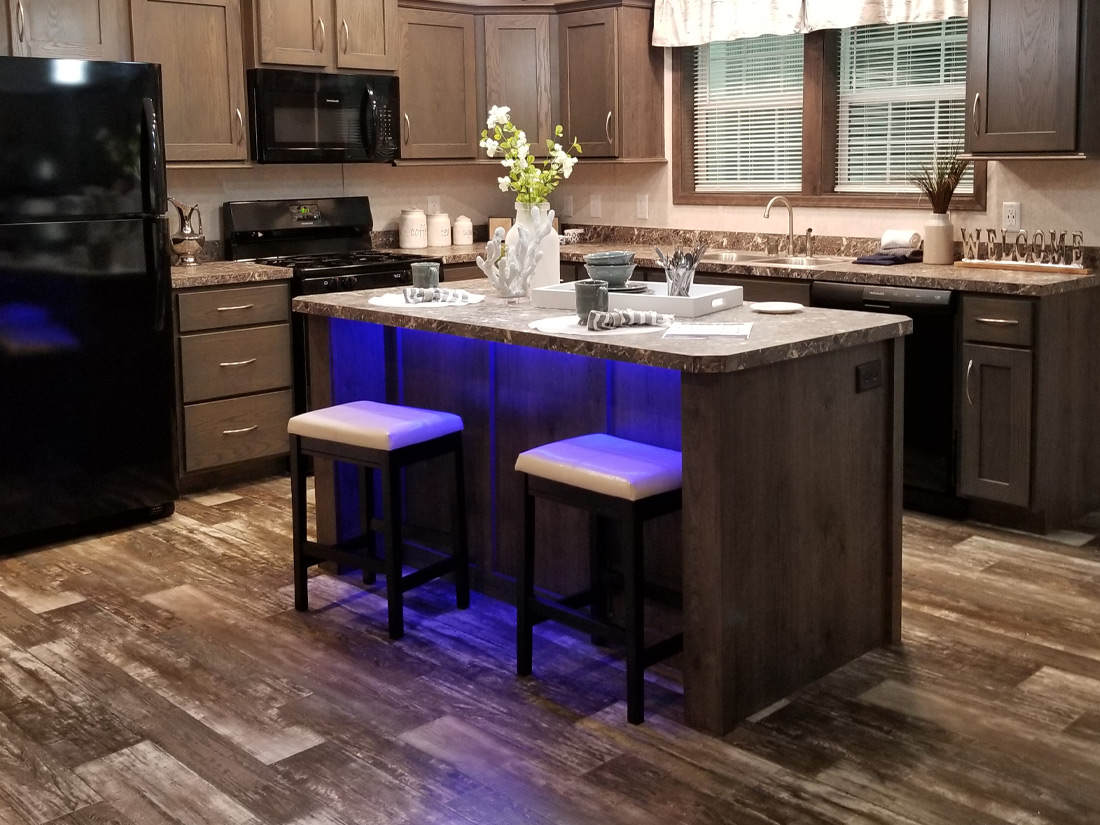 Manufactured home kitchen with blue under counter light cropped
