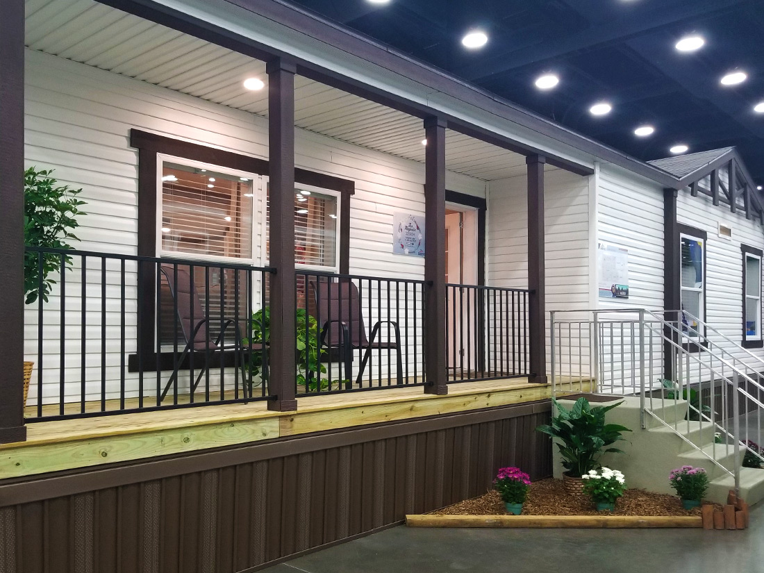 Manufactured home with railed porch angled view