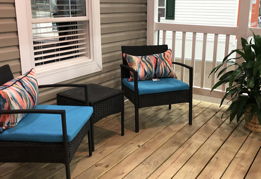 Manufactured-home-porch-with-colorful-chairs